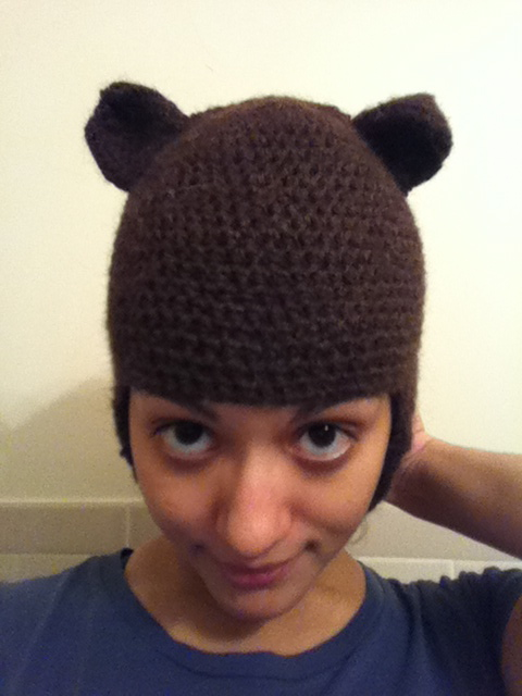 Bear hat with ear flaps.