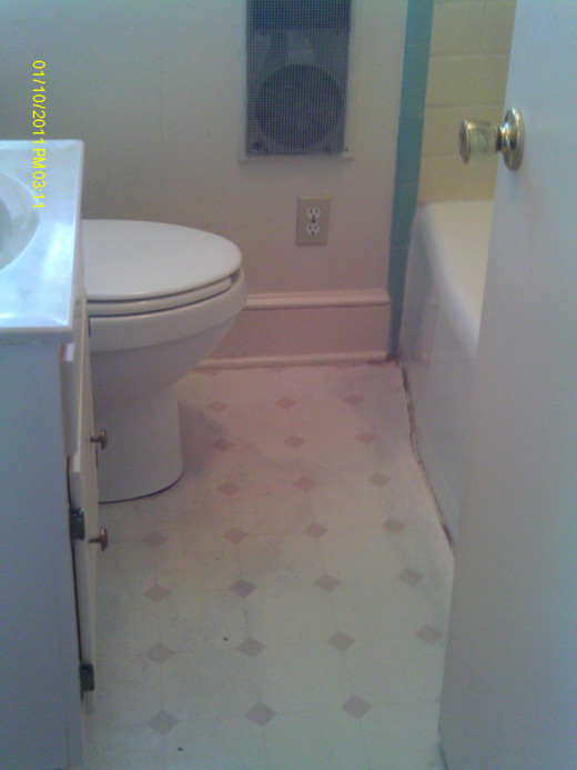 Dull, unattractive bathroom before fixing up