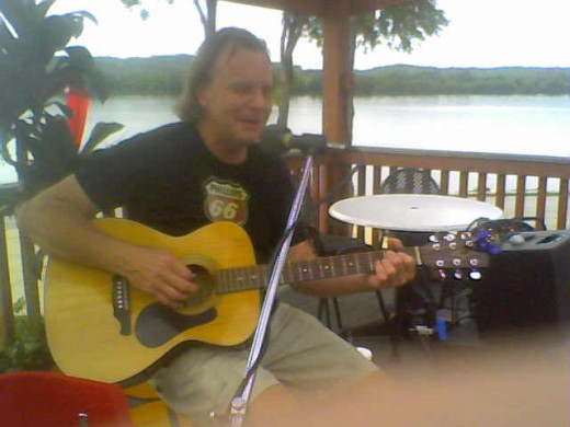 Hey Mr. Tambourine Man Play A Song For The Universe -- Michael Kruse at the Sunset Bar & Grill in Warsaw, Kentucky.