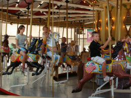 Riding the Charles W. Parker carousel.