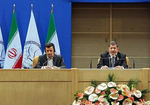 Left, Ahmadinejad for Iran, Morsi, to his right, scolding Iran.