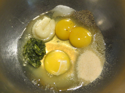 There are only two eggs, one of the eggs had two yolks in it.  I then mixed the garlic, salt, pepper, basil, and onion powder with a fork.