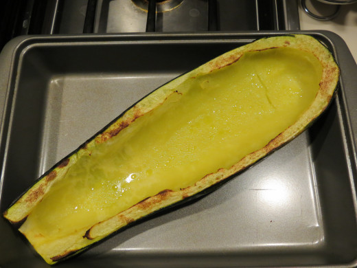 Lightly coat the inside and edgeof lcored zucchini half with olive oil and sprinkle the inside and edges with a light coat of garlic powder.   Broil zucchini until the core turns dark yellow and the edges are slightly browned.