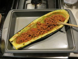 Fill zucchini half with ground beef and tomato sauce mixture and top with mozzerella cheese.  Bake at 375 degrees for 15 minutes or until the cheese is slightly browned.