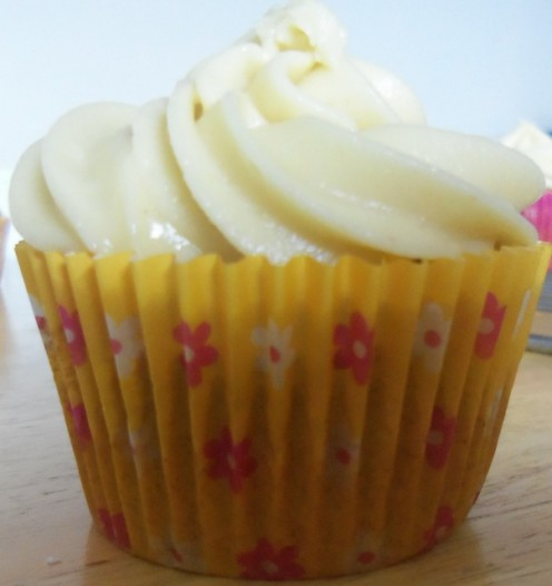 A spiced cupcake with maple frosting