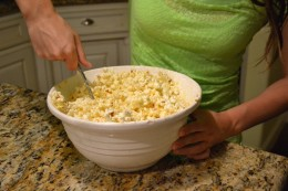 It might seem difficult to get all the popcorn coated with marshmallow mixture, but it's really pretty easy. Just keep stirring and turning up from the bottom of the bowl.