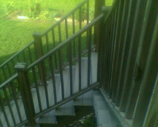 Our back deck stairs, backyard, and garden. So much more can be done with the space.