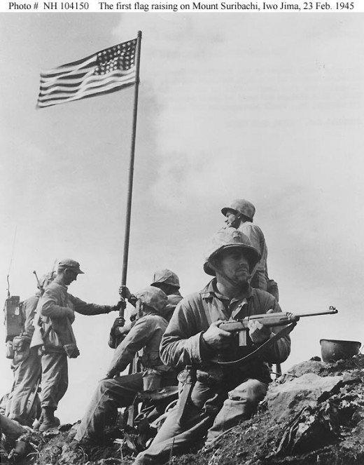 Flag on Suribachi - but the Navy photo, not the famous one by Joe Rosenthal, whose picture was actually of the second flag raised.