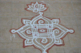 Traditional Maavu Kolam (Raw rice flour rangoli)