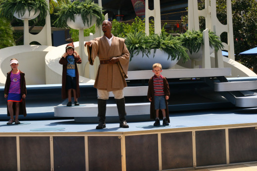 The author's five year old son stands next to the Jedi Master on stage.