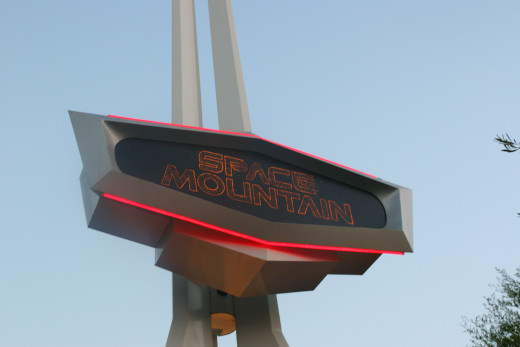 Space Mountain is a roller coaster through space - the effect is very realistic and is the author's favorite attraction at Disneyland.