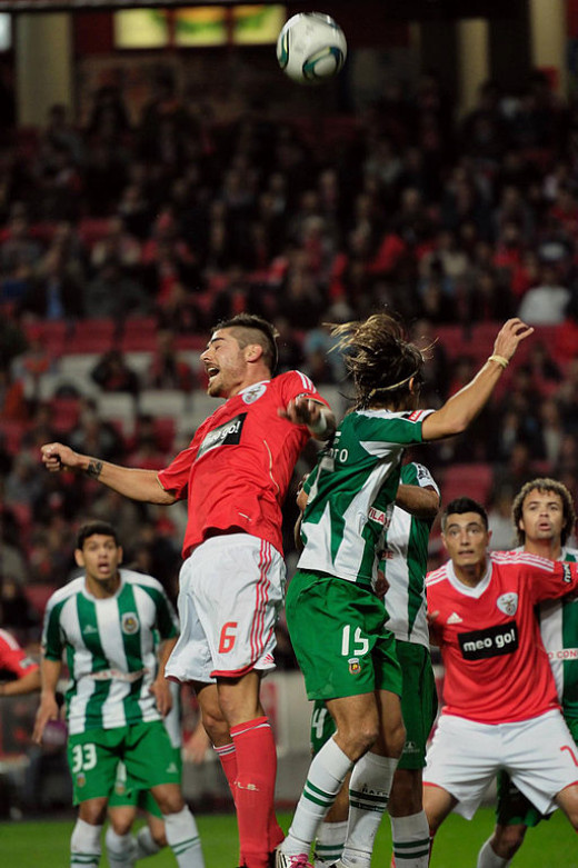 Javi Garcia tries for a header (in red), while he played for Benfica.