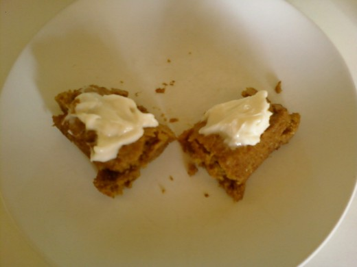 Pumpkin cookie bars topped with cream cheese frosting