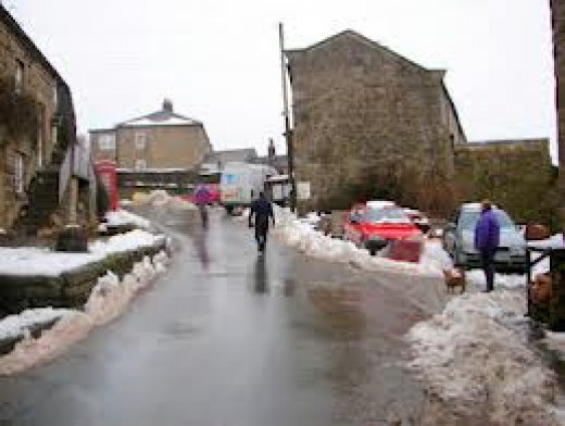 Middlesmoor, looking up the main street with winter snows evident. Not always the best for walking, but feel the crunch of settled snow under your feet as you descend on the local hostelry after a scenic drive