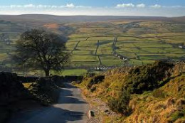 Looking down the road out of Middlesmoor - take in the panorama of green, the patchwork of fields knitted together by tall dry stone walls characteristic of the Dales