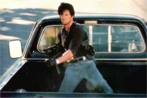 Cobra starring Sly Stallone was an action classic from the 1980s. It features a cop that will do anything to get the bad guy.
