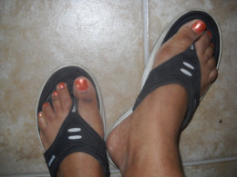 Toe nails painted with bronze polish.
