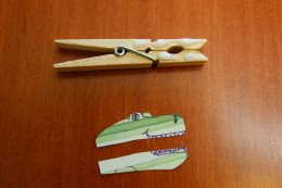 Cut out an animal shape, cut it in half, and glue it to a clothespin. Glue a letter to the back of the clothespin.