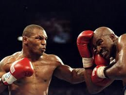Mike Tyson vs Evander Holyfield 2 ended when Tyson bit Holyfield on the ear for the second time.Evander Holyfield beat Tyson twice in title bouts.