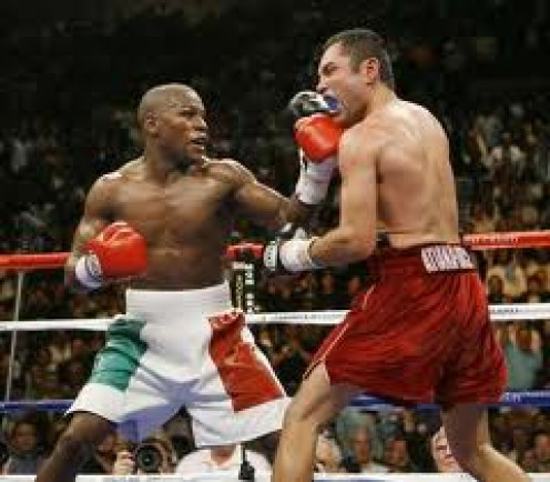 Floyd Mayweather vs Oscar De La Hoya is the largest grossing PPV in boxing history. Mayweather won a close split decision in 12 rounds and he captured the Jr. Middleweight belt in the process.