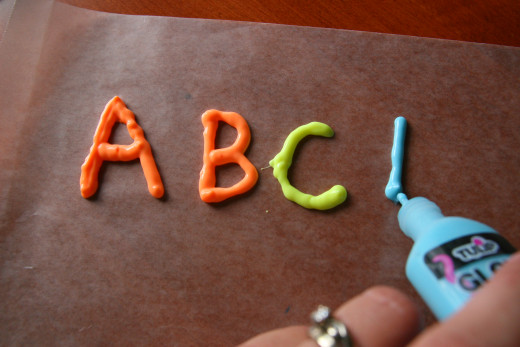 Use dimensional paint and pipe letters onto wax paper. Once dry, they will make window clings.