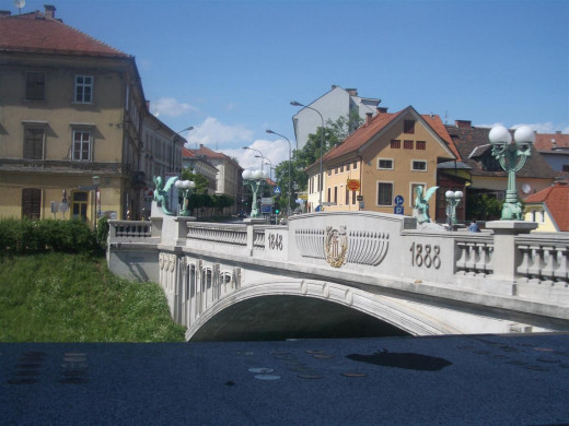 One of the three bridges of the Triple Bridge - a group of three bridges across the Ljubljanica River. It connects the Ljubljana's historical, medieval, town on one bank, and the modern city of Ljubljana on the other.