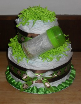 Instead of topping the cake with a bottle, I though placing the bottle in the front was a nice touch.
