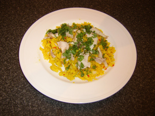 Chicken and coriander are stirred in to the rice