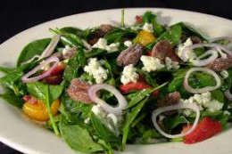 Spinach salad is a very healthy way of eating good and tasty food.