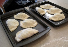 The calzones are ready to go into the oven.