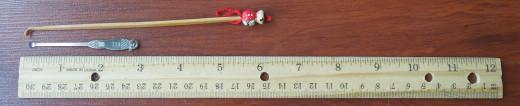 A bamboo ear picker, A metal ear picker and a ruler.