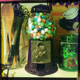 Gumball machine filled with marbles.