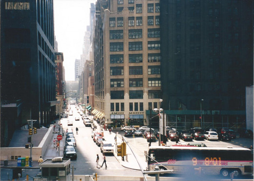 My hotel is behind the first building on the right.  Wall Street is the next street to the left.