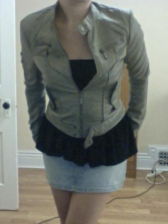 Wearing a flared mini skirt as a peplum tube top.