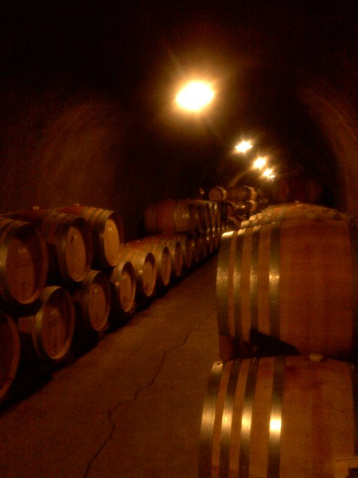 Barrels of wine line the catacombs underneath the castle