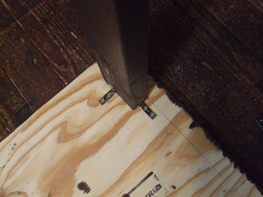 Underside of table showing leg attachment.