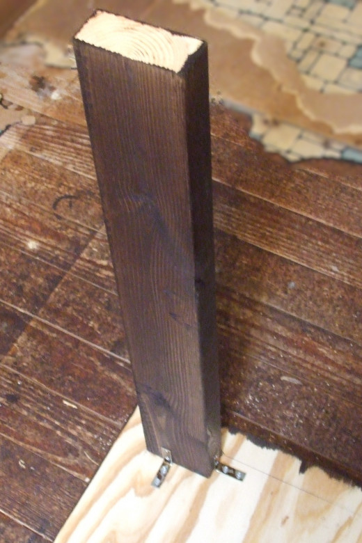 Another view of table leg attached to underside of table.