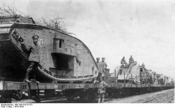 WWI 1917: British tanks captured by the Germans being transported by rail.