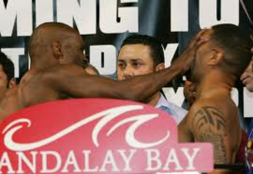 Bernard Hopkins slaps Winky Wright at their weigh in. It was a tactical bout which Hopkins won by unanimous decision.
