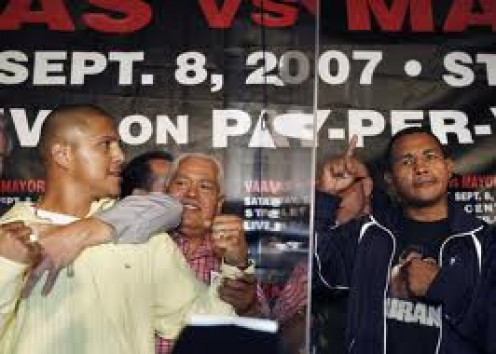 Ricardo Mayorga and Fernando Vargas separated by Glass. El Matador has a way of getting under his opponents skin and he definitely got under Vargas's skin.