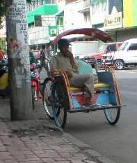 A three-wheeled pedicab or Becak.