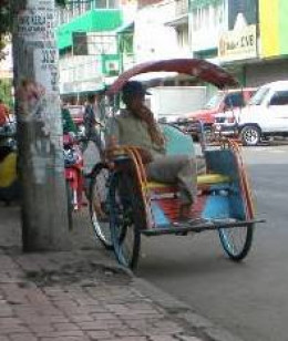 A three-wheeled pedicab or Becak.