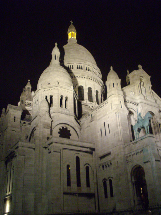 Sacre Coeur in Paris at night.  The view from the top gives a fantastic view of Paris with the Eiffel tower in the background.  Best of all, it free.