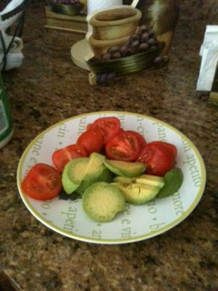 A small salad with tomatoes and avocados