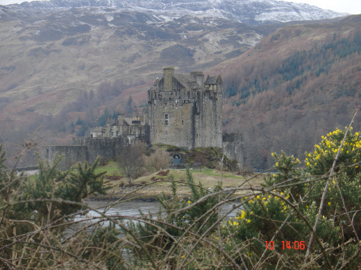 Eilean Donan Castle against the stark landscape of Scotland on  a cold day in February.