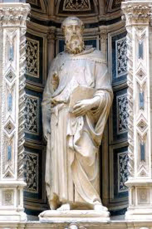 Saint Mark outside of a Cathedral. Their are many statues of this Saint throughout the world. He wrote one of the Epistles in the New Testament.