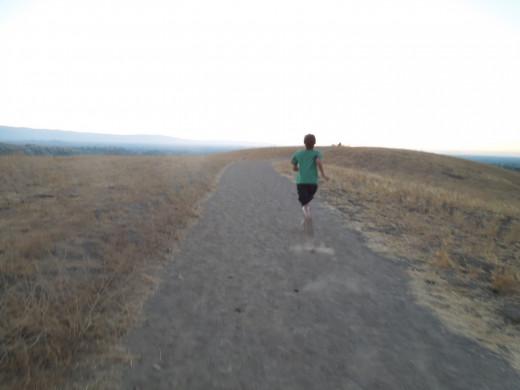 A Kid Running in Montgomery Hill Park San Jose CA