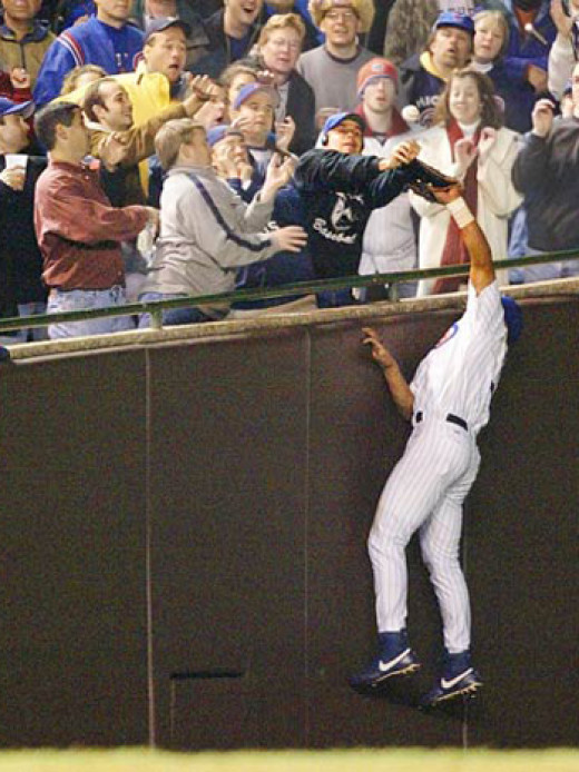 Cub fan Steve Bartman deflects the second out of the 7th inning in Game 6 of the 2003 NLCS.  The Marlins proceeded to score eight runs before the Cubs got the third out.