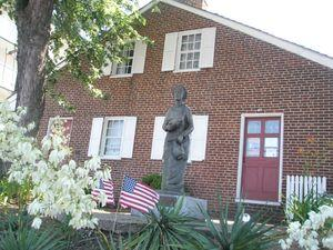 The Jennie Wade house,with a statue of Jennie gaurding over the property.
