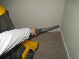 Eureka Bagless Upright Vacuum Cleaner - Vacuuming A Corner.